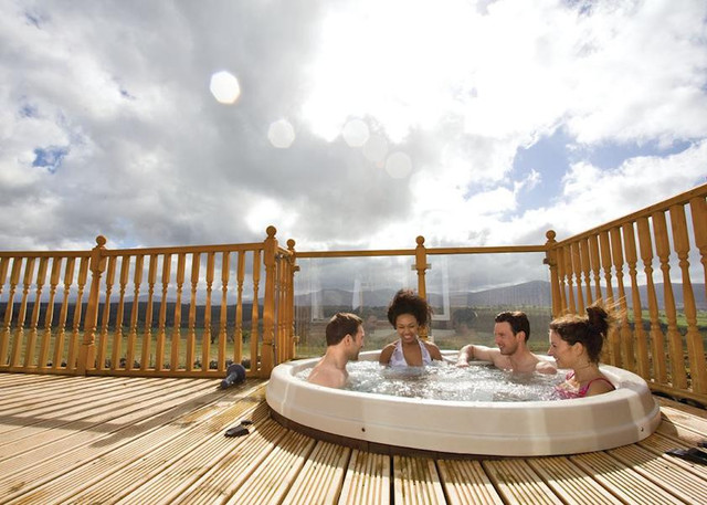 Re-design Lodges with Hot Tubs Page