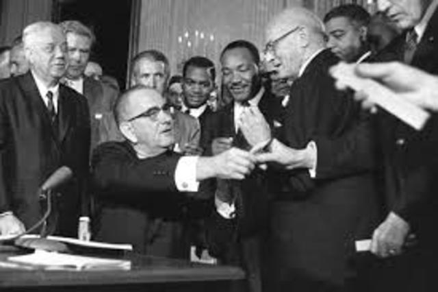 Johnson signs the Civil Rights Act of 1964.