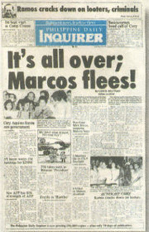 Ferdinand Marcos flees the Philippines