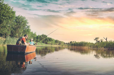 Father and Son Fishing in a Boat