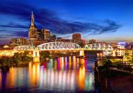 The Nashville skyline with a view of the John Seigenthaler Pedestrian Bridge