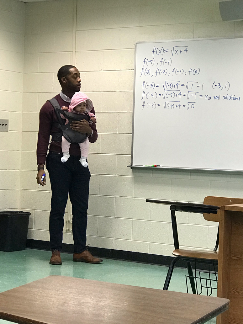 Morehouse visiting professor Nathan Alexander lent a hand to a student who brought his baby to class.