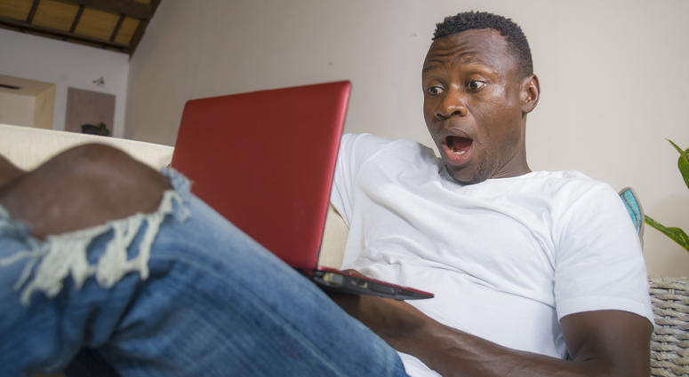 Surprised man at computer