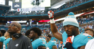 NFL players protest during anthem, drawing rebuke from Trump