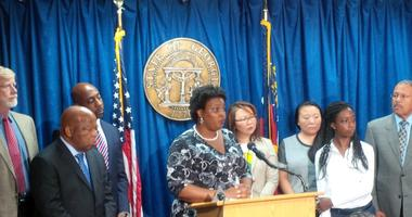 Democratic Candidate for GA Governor Stacey Abrams, along with Congressmen and other officials talking about voter rights on October 6, 2014.