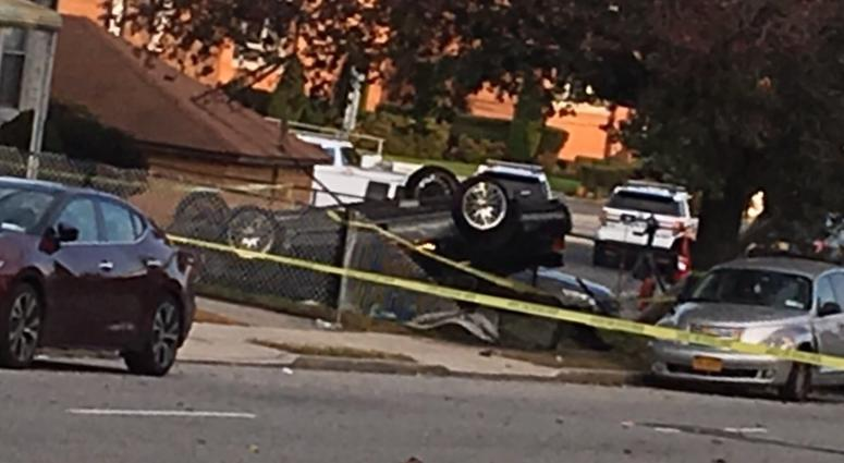 Overturned car in Elmont