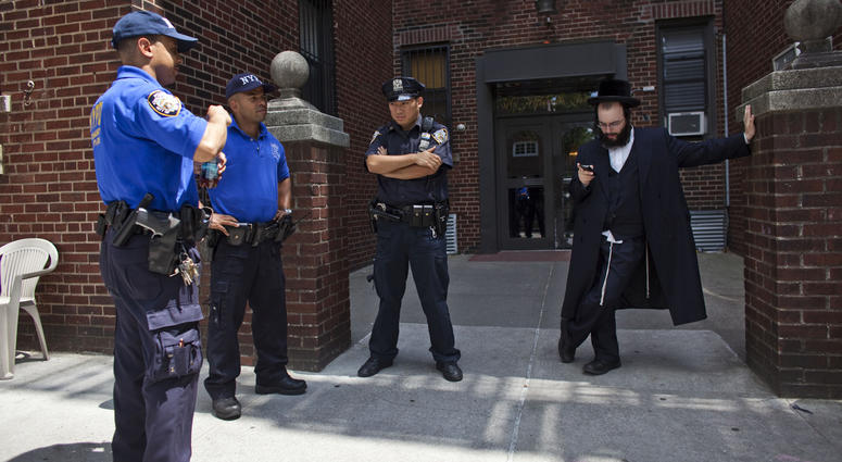 Hasidic man protected by NYPD