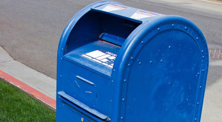 Drop box for mail on the corner of a street.