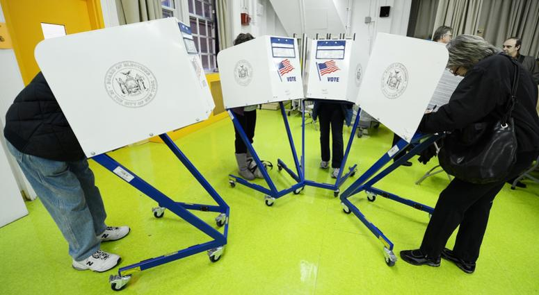 Residents cast their ballots to vote in the 2012 General Election at Yorkville Community School located on 421 East 88th Street on the Upper East Side of Manhattan