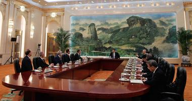 Chinese President Xi Jinping, center, meets with U.S. Trade Representative Robert Lighthizer, fifth from left, U.S. Treasury Secretary Steven Mnuchin, fourth from left, and delegations from both countries at the Great Hall of the People in Beijing, Friday