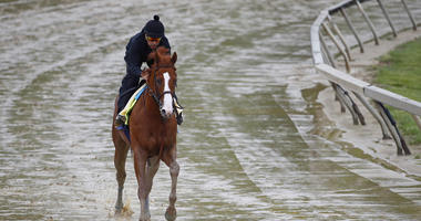 Kentucky Derby winner Justify, with exercise rider Humberto Gomez aboard, gallops around the track, Thursday, May 17, 2018, at Pimlico Race Course in Baltimore. The Preakness Stakes horse race is scheduled to take place Saturday, May 19.
