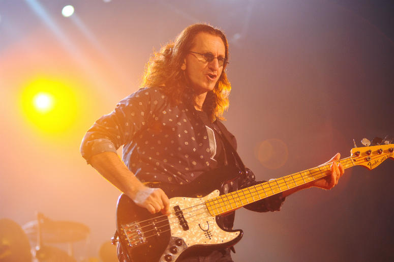 Geddy Lee, lead vocalist and bassist of iconic Canadian rock band Rush, performs on stage at Copps Coliseum