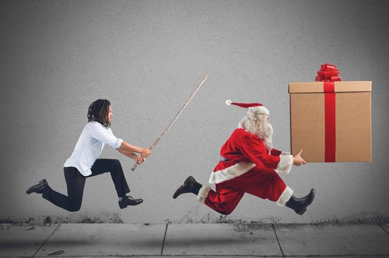 Man chasing Santa with package