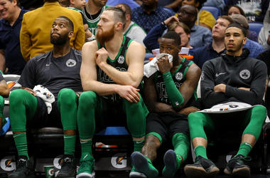 The Celtics bench is dejected.