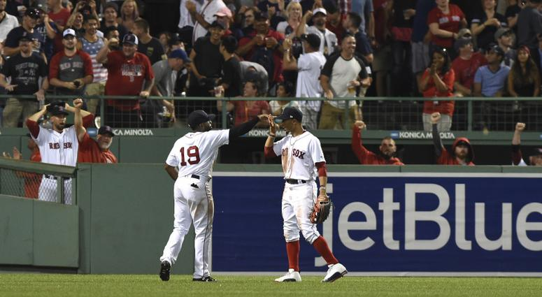 Red Sox outfielder Jackie Bradley (left) celebrates robbing Aaron Judge with Mookie Betts.