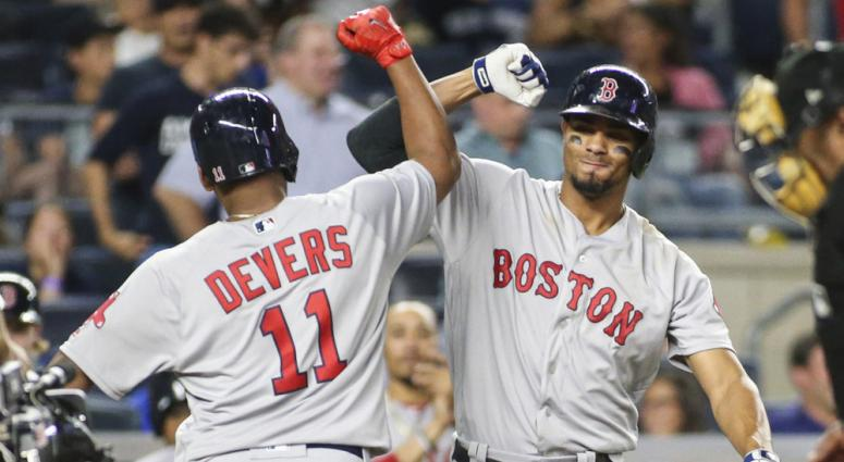 Rafael Devers (left) is congratulated by Xander Bogaerts.