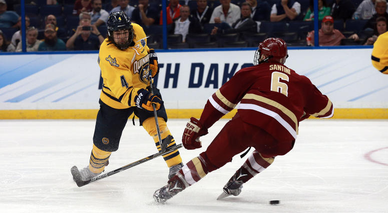 Apr 7, 2016; Tampa, FL, USA; Quinnipiac Bobcats defenseman Connor Clifton (4) shoots as Boston College Eagles defenseman Steve Santini (6) attempts to defend during the second period of the semifinals of the 2016 Frozen Four college ice hockey tournament