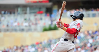 Jun 21, 2018; Minneapolis, MN, USA; Boston Red Sox right fielder Mookie Betts (50) hits a single during the ninth inning against the Minnesota Twins at Target Field.