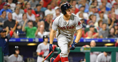 Boston Red Sox second baseman Brock Holt (12) hits a pinch hit home run during the eighth inning against the Philadelphia Phillies
