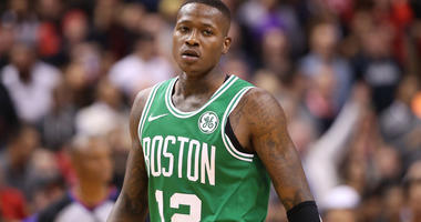 Oct 19, 2018; Toronto, Ontario, CAN; Boston Celtics guard Terry Rozier (12) looks on against the Toronto Raptors at Scotiabank Arena. The Raptors beat the Celtics 113-101. Mandatory Credit: Tom Szczerbowski-USA TODAY Sports