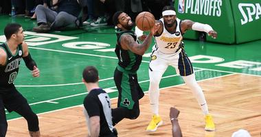 Boston Celtics guard Kyrie Irving and Indiana Pacers guard Wesley Matthews