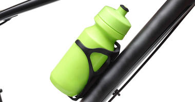Reusable green water bottle on bike cup holder
