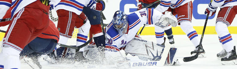 Rangers goaltender Henrik Lundqvist makes a save against the Washington Capitals on March 29, 2018, at Capital One Arena in Washington.