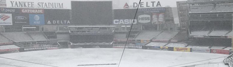 Snow is seen on the field of Yankee Stadium on April 2, 2018.