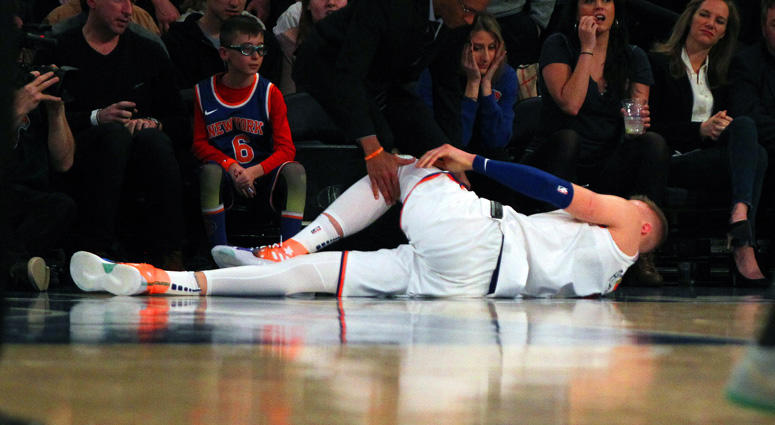 Kristaps Porzingis (6) lays on the court after being injured against the Milwaukee Bucks on Feb. 6, 2018.