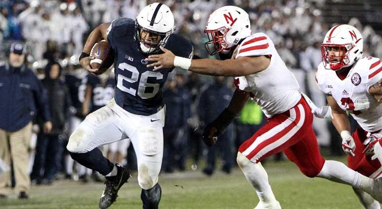 Penn State running back Saquon Barkley (26) runs the ball against Nebraska on Nov. 18, 2018, at Beaver Stadium in University Park, Pennsylvania.