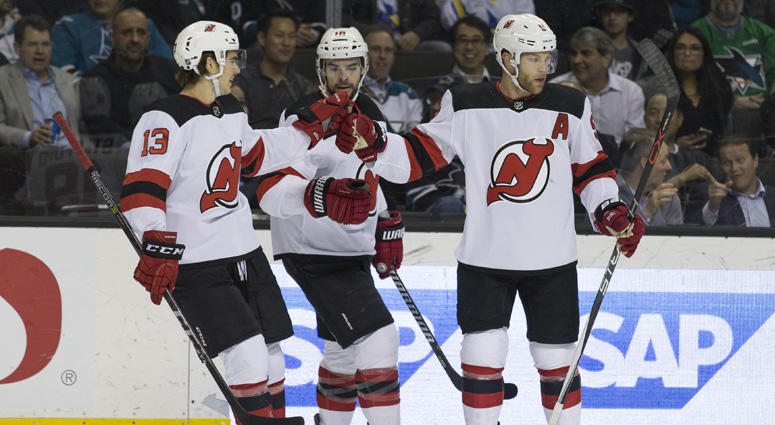 The Devils' Taylor Hall (right), center Nico Hischier and right wing Drew Stafford celebrate after a goal against the San Jose Sharks on March 20, 2018, at the SAP Center in San Jose, California.