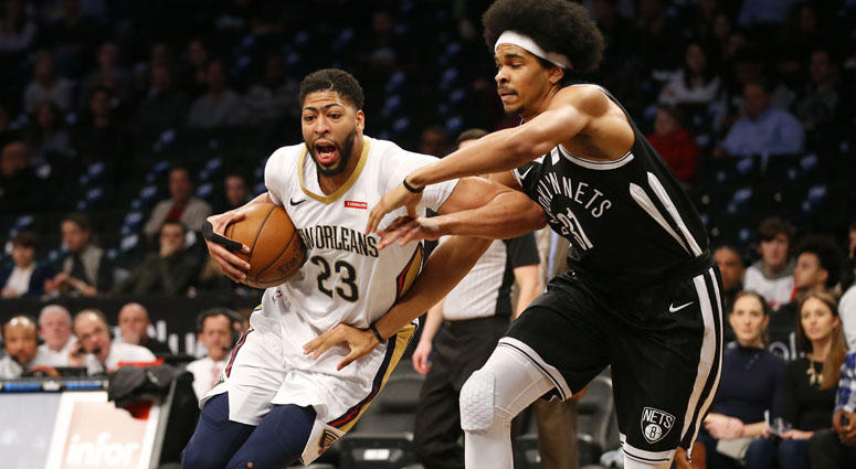 The Nets' Jarrett Allen defends the New Orleans Pelicans' Anthony Davis
