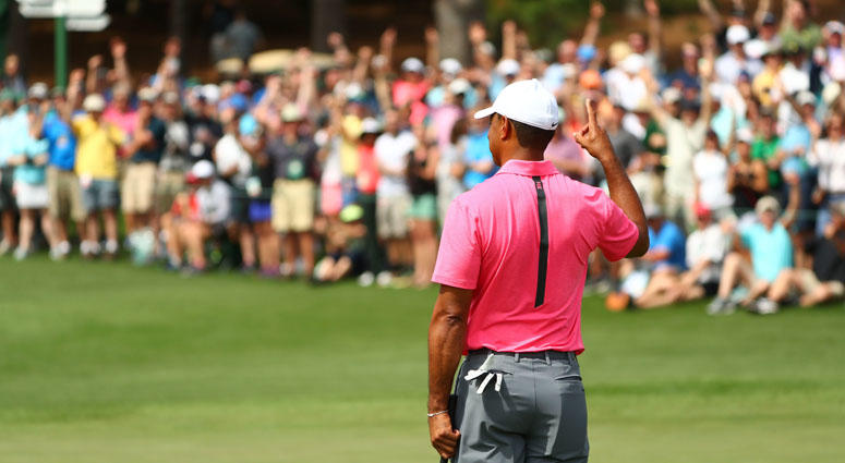 Tiger Woods reacts after making a putt from off the green for eagle on the second hole during a practice round for the Masters on April 2, 2018, at Augusta National.