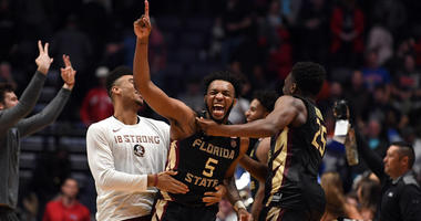 Florida State's PJ Savoy (5) celebrates after defeating Xavier in the second round of the NCAA tournament on March 18, 2018, at Bridgestone Arena in Nashville, Tennessee.