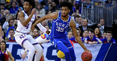 Duke's Marvin Bagley III handles the ball against Kansas guard Devonte' Graham during the semifinals of the Midwest regional of the NCAA tournament on March 25, 2018, at the CenturyLink Center in Omaha, Nebraska.