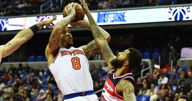 The Knicks' Michael Beasley shoots over the Wizards' Markieff Morris on March 25, 2018 at Capital One Arena in Washington, D.C.