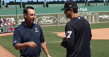 Aaron Boone and Tim Wakefield chat before a spring training game in Fort Myers, Florida in March 2018.