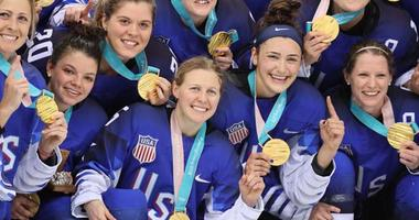 The USA women's hockey team celebrates winning the gold medals at the Winter Olympics in Pyeongchang, South Korea.