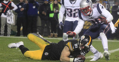 Pittsburgh Steelers tight end Jesse James fails to hold the ball as he falls across the goal line against New England Patriots on Dec. 17, 2018, at Heinz Field in Pittsburgh.