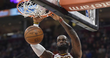 Cavaliers forward LeBron James dunks in the third quarter against the Detroit Pistons on March 5, 2018, at Quicken Loans Arena in Cleveland.