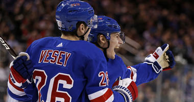 Rangers center Lias Andersson (right) celebrates with teammate Jimmy Vesey after scoring his first career goal on March 26, 2018, against the Washington Capitals at Madison Square Garden.