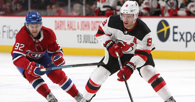 The Devils' Taylor Hall plays the puck against the Canadiens' Jonathan Drouin on April 1, 2018, at the Bell Centre in Montreal.