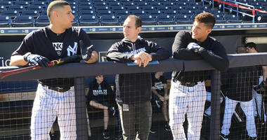 From left, Yankees catcher Gary Sanchez, interpreter Marlon Abreu and infielder Gleyber Torres. (credit: Sweeny Murti/WFAN)