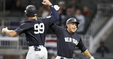The Yankees Giancarlo Stanton celebrates a home run with Aaron Judge (99) during a spring training game against the Atlanta Braves on March 26, 2018, SunTrust Park in Atlanta.