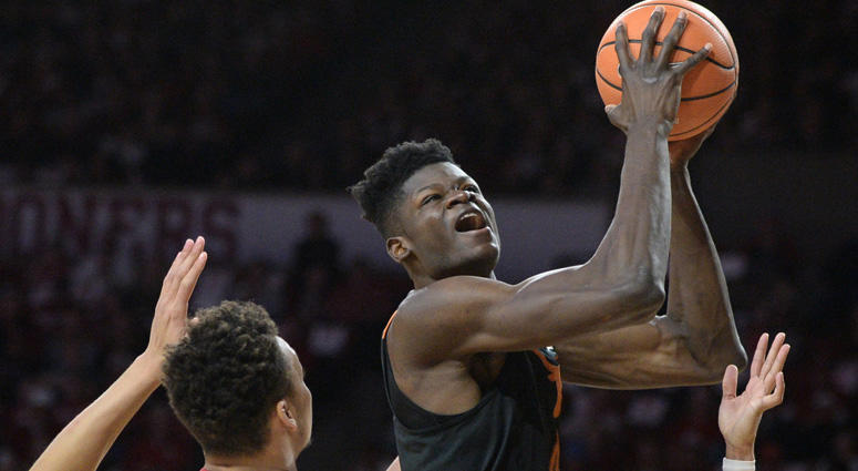 Texas' Mohamed Bamba is fouled while playing Oklahoma on Feb. 17, 2018, at Lloyd Noble Center in Norman, Oklahoma.