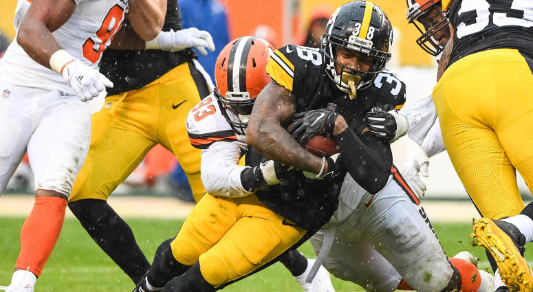 Oct 28, 2018; Pittsburgh, PA, USA; Pittsburgh Steelers running back Jaylen Samuels (38) and Cleveland Browns defensive tackle Trevon Coley (93) in action during the game at Heinz Field. Mandatory Credit: Jeffrey Becker-USA TODAY Sports