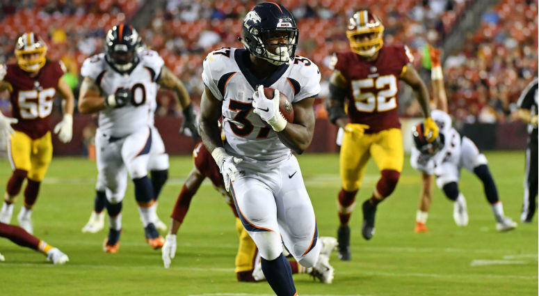 Royce Freeman runs for a touchdown against the Washington Redskins during the first half at FedEx Field.