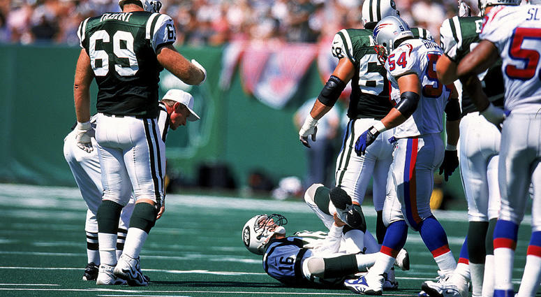 The Jets' Vinny Testaverde grabs his leg in pain on Sept. 12, 1999, against the New England Patriots at Giants Stadium.