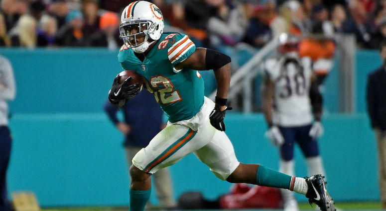 Kenyan Drake runs the ball against the New England Patriots during the second half at Hard Rock Stadium in Miami.