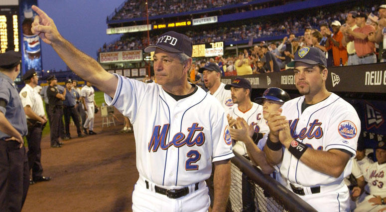 Mets manager Bobby Valentine and catcher Mike Piazza applaud in honor of New York City Mayor Rudy Giuliani before the Mets' game against the Atlanta Braves on Sept. 21, 2001, at Shea Stadium.